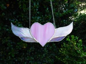 A smaller, simplified heart with wings